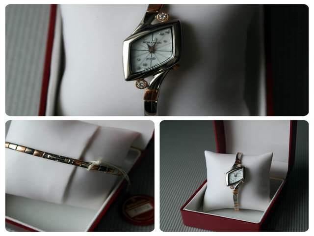 Часы оригинальной формы из драгметалла с камнями